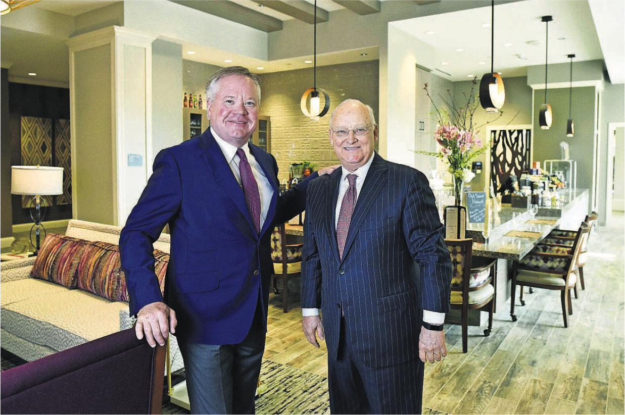 John Goff (left) and Denny Alberts stand near the dining area in their latest project, HarborChase of the Park Cities. The 134 assisted-living and memory-care apartments look a lot like trendy urban rentals in Uptown but are adapted for the needs of the slower set. (Ben Torres/Special Contributor)